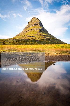 Snaefellsnes peninsula, Iceland. Kirkjufell Mountain reflecting on water.