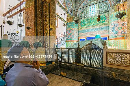 Worshiper praying on Mevlana s Tomb at Mevlana Museum, Konya, Turkey