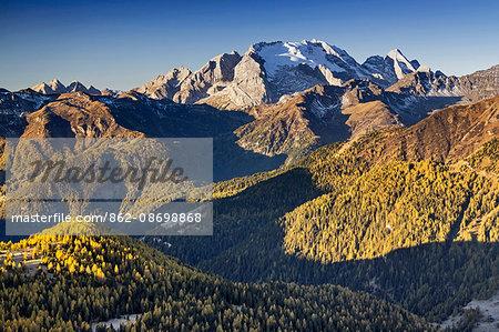 Europe, Italy, Veneto, Belluno. The grassy ridge of Padon, behind it the Marmolada, Dolomites