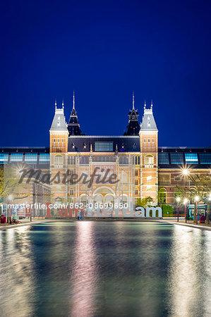 Netherlands, North Holland, Amsterdam. The Rijksmuseum on Museumplein at night.