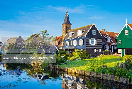 Netherlands, North Holland, Marken. Wooden houses along a canal in Kerkbuurt village.