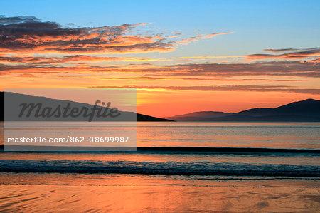 Scotland, Western Iles, Isle of Harris. A summer sunset at Luskentyre.