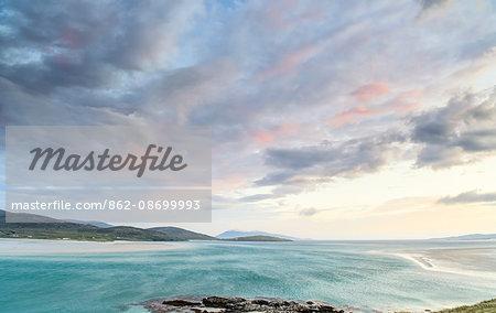 Scotland, Western Isles, Isle of Harris. Pastel sky over Luskentyre Bay at sunset.
