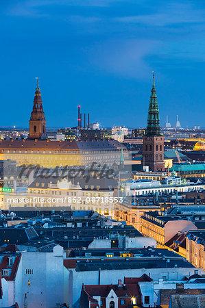 Denmark, Hillerod, Copenhagen. Elevated view towards Hotel D'Angleterre and Christiansborg Slot at dusk.
