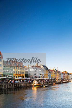 Denmark, Hillerod, Copenhagen. Colourful buildings along the 17th century waterfront of Nyhavn.
