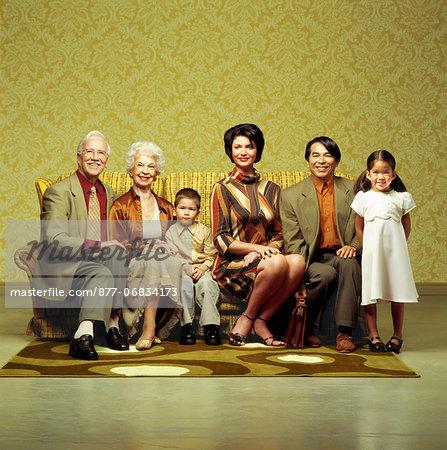 Three generation family sitting in sofa