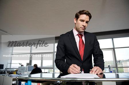 Businessman filling out a paper