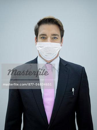 Businessman wearing swine flu mask