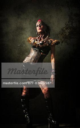 Alternative woman poses in studio