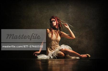 Redhead woman sitting in white dress