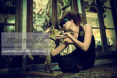 Seated Woman petting a stuffed fox