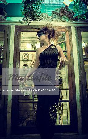 Woman standing in profile in black dress