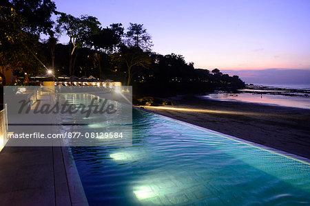 Swimming pool of Four Seasons Resort Bali at Jimbaran Bay in Bali island, Indonesia, South East Asia