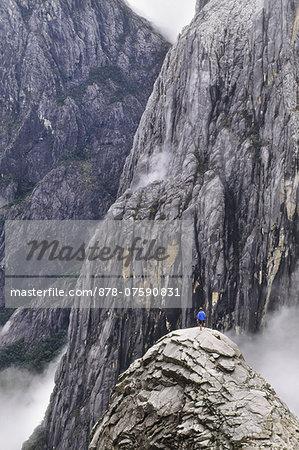 Climber on summit, Mt Kinabalu National Park, Sabah, Borneo