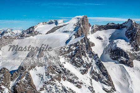 Aerial view of Cima di Castello with Punta Rasica and Allievi in winter. Valmasino, Valtellina Lombardy, Italy Europe