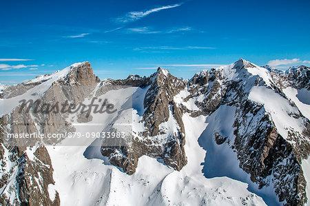 Aerial view of the peaks of Val di Zocca in winter, including Cima di Castello, Punta Rasica and Pizzo Torrone. Valmasino, Valtellina Lombardy, Italy Europe