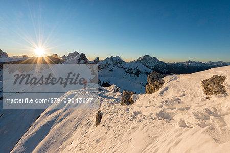 Nuvolau, Dolomites, Veneto, Italy. Mountaineer on the ridge to the summit of Nuvolau.