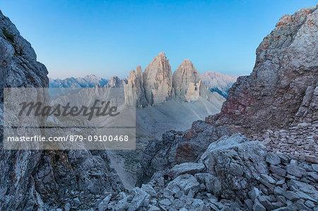 Sunrise from the top of mount Paterno / Paternkofel towards Tre Cime di Lavaredo, Sexten Dolomites, South Tyrol, Bolzano, Italy