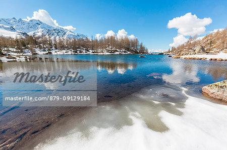 Lago Acque Sparse partially frozen, Val Grosina, Valtellina, province of Sondrio, Lombardy, Italy