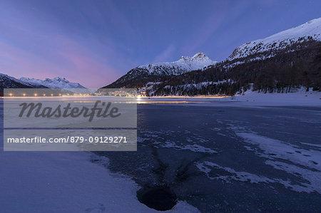 Piz Julier and Piz Da La Margna seen from frozen Lake Champfer at dusk, Silvaplana, canton of Graubunden, Engadin, Switzerland