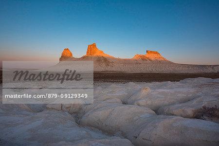 Rock formations at sunrise at Boszhira at Caspian Depression desert, Aktau, Mangystau region, Kazakhstan