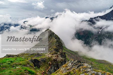 Clouds around Mount Disgrazia, Chiareggio, Valmalenco, Province of Sondrio, Lombardy, Italy