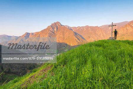 Hiker on the summit of Crocetta, Val Brembana, Orobie alps, Italian alps, Province of Bergamo, Italy