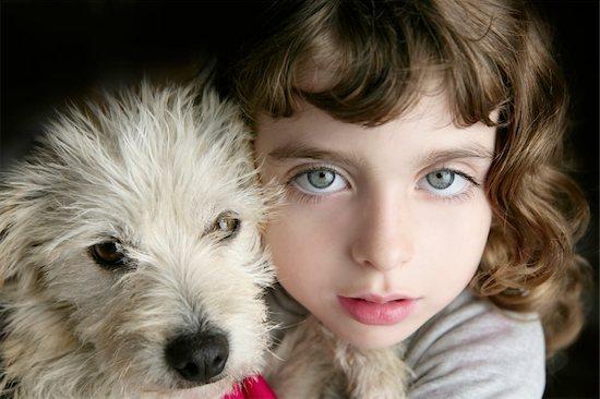 dog puppy and girl hug portrait closeup blue eyes white hairy little doggy Stock Photo - Royalty-Free, Artist: lunamarina, Image code: 400-04862633