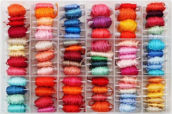 Colorful bobbins in the plastic box. Close up Stock Photo - Royalty-Free, Artist: DashaPetrenko, Image code: 400-05748785