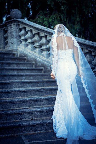 Beautiful bride walks up the stairs Stock Photo - Royalty-Free, Artist: Deklofenak, Image code: 400-07297488