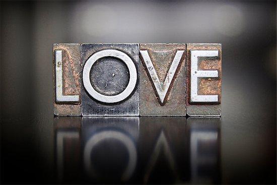 The word LOVE written in vintage lead letterpress type Stock Photo - Royalty-Free, Artist: enterlinedesign, Image code: 400-07628991