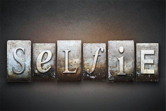 The word SELFIE written in vintage letterpress type Stock Photo - Royalty-Free, Artist: enterlinedesign, Image code: 400-07893222