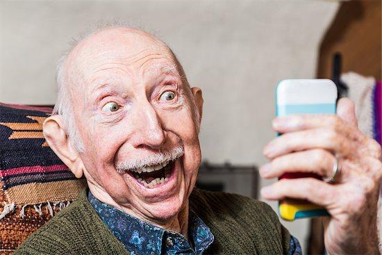 Elderly gentleman taking a selfie with smartphone Stock Photo - Royalty-Free, Artist: creatista, Image code: 400-08255006