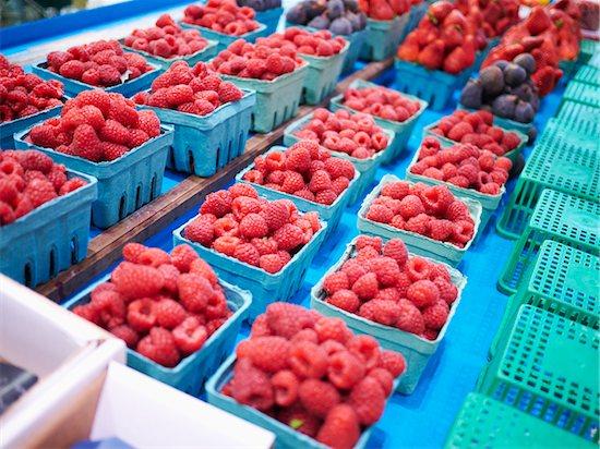 Cartons of Raspberries at Market Stock Photo - Premium Royalty-Free, Artist: Michael Alberstat, Image code: 600-05560311