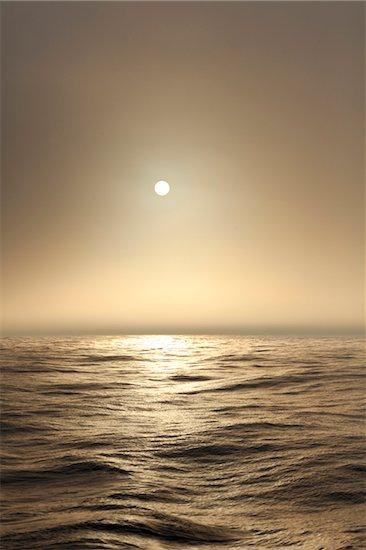 The Atlantic ocean illuminated off the coast of Nova Scotia in fog with the sun shining through. Stock Photo - Premium Royalty-Free, Artist: Michael Eudenbach, Image code: 600-06782114