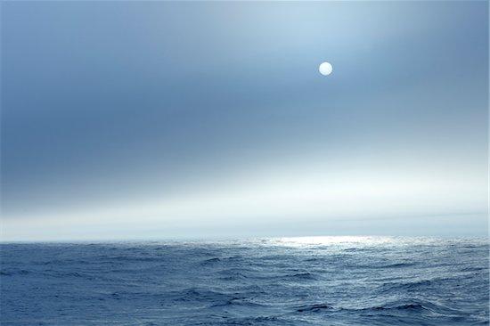 The Atlantic ocean illuminated off the coast of Nova Scotia in fog with the sun shining through. Stock Photo - Premium Royalty-Free, Artist: Michael Eudenbach, Image code: 600-06782112
