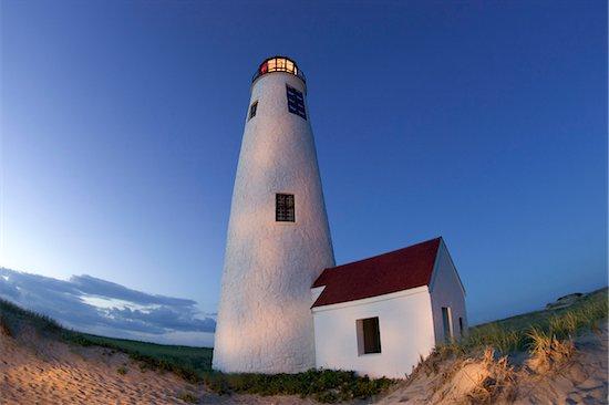 Great Point lighthouse, (also known as Nantucket Light) illuminated at dusk, Nantucket, Massachusetts, USA Stock Photo - Premium Royalty-Free, Artist: Michael Eudenbach, Image code: 600-07945102