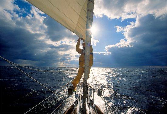 Man adjusting the jib while sailing offshore on the Atlantic Ocean. Stock Photo - Premium Royalty-Free, Artist: Michael Eudenbach, Image code: 600-07945122
