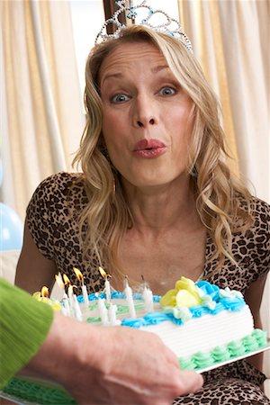 Woman Receiving Birthday Cake Stock Photo