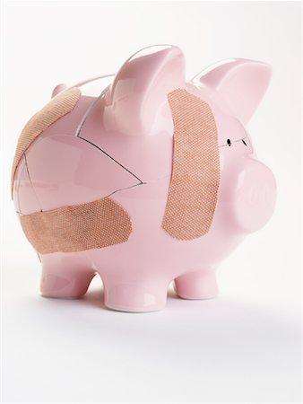 How to fix a broken piggy bank Stock Photos - Page 1 : Masterfile