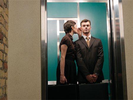 people talking in elevator. business people in elevator stock photo - premium royalty-free, code: 600- talking n