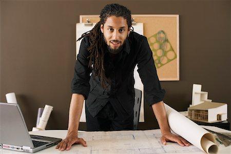 Interior designer african american male with dreadlocks Stock