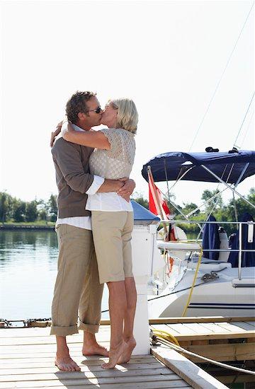 Couple on Dock at Marina Stock Photo - Premium Royalty-Free, Artist: Masterfile, Image code: 600-01173396