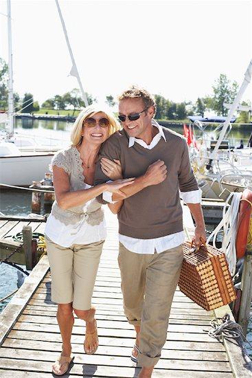 Couple on Dock at Marina Stock Photo - Premium Royalty-Free, Artist: Masterfile, Image code: 600-01173393
