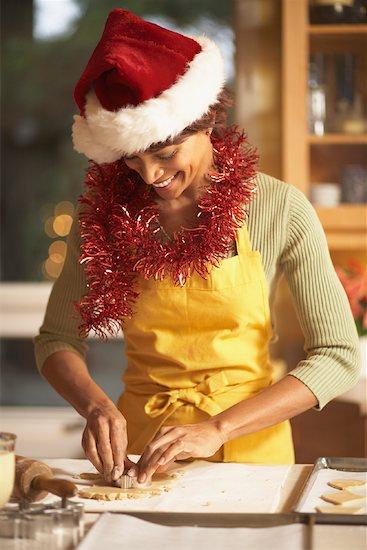 Woman in Santa Hat Making Cookies Stock Photo - Premium Royalty-Free, Artist: Jerzyworks, Image code: 600-01183004