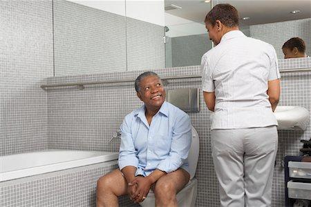 Black guy on toilet