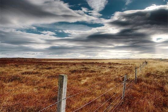 Wire Fence in Field, Borgarfjordur, Iceland Stock Photo - Premium Royalty-Free, Artist: Atli Mar Hafsteinsson, Image code: 600-02463534