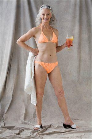 senior adult women towel stock photos - page 1 : masterfile