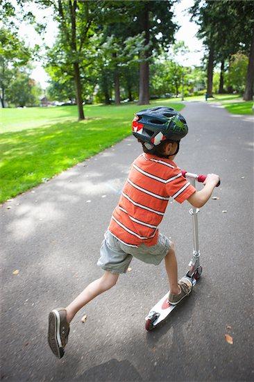 Boy Riding Scooter, Washington Park, Portland, Oregon, USA Stock Photo - Premium Royalty-Free, Artist: Ty Milford, Image code: 600-03865181