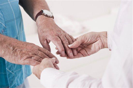 Close-up of Caregiver holding Patient's Hands Stock Photo - Premium Royalty-Free, Artist: Uwe Umstätter, Image code: 600-03907113